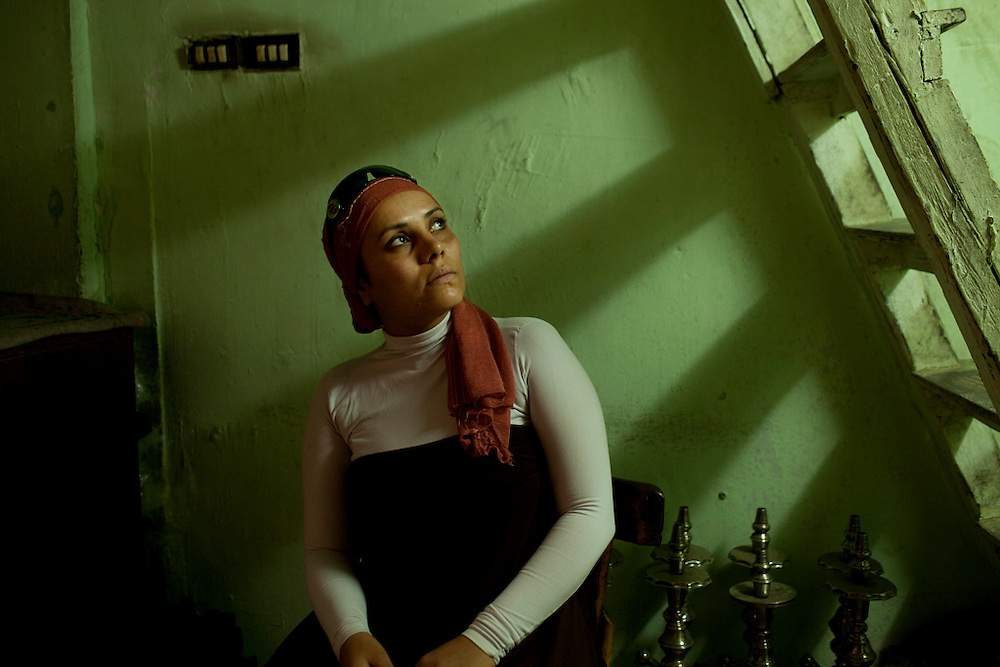 Rasha Ali Abdulraham, 28, was at a protest in Tahrir Square on March 9, 2011 when she and 172 other demonstrators, including 17 women, were arrested and forcefully removed from the demonstrations. After being bound and tortured at the Egyptian Museum for seven hours, she and the others were loaded onto buses and brought to Heikstep, a military detention center.  There, the women were forced to divide into two groups: virgins and non-virgins.  She and six others, who identified as the former, were then subjected to 'virginity tests' in which military officers examined each woman's vagina for an extended period of time for the presence of an intact hymen.  When she was released four days later, she wanted to press charges against the military for sexual assault, but was unable to do so due to legal reasons.   Abdelrahman said it took her months to process the trauma and that months later, she still suffers from stress of the incident.