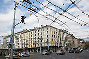 Street scene with overhead tram wires in Geneva, Switzerland.