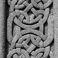 Europe, Ireland, Glendalough. Cletic Patterns on Cross at Glandalough.