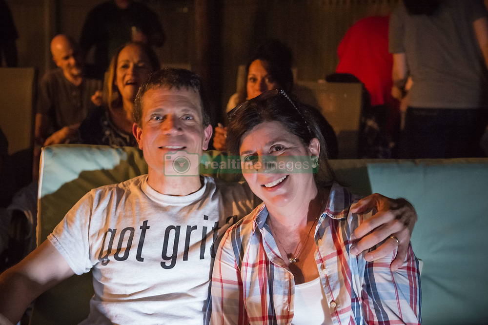 June 11, 2017 - Merrick, New York, United States - 'American Grit' TV contestant CHRIS EDOM, 48, (wearing GOT GRIT? T-shirt), has his arm around shoulder of his wife JOAN EDOM, both of Merrick, as they host backyard Viewing Party for Season 2 premiere. Show. Edom family relatives and neighbors watched Episode 1 of FOX network reality television series  that Sunday night outdoors. has a military mentor. (Credit Image: © Ann Parry via ZUMA Wire)