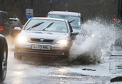 © London News Pictures. 26/01/2014. London, UK. A car drives through a deep puddle on a road caused by heavy rain in St John's Wood, North London . Photo credit: Ben Cawthra/LNP