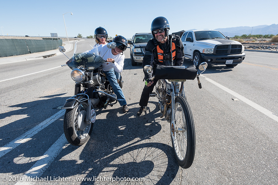 Motorcycle Cannonball insurance sponsor Greg Allen (L) and Pamela Sanwald on Gregs restored BMW as they follow centennial riders from coast to coast beside Harley-Davidson Museum Archive Restorer/Conservator Bill Rodencal of Wisconsin on his 1915 Harley-Davidson as they come into Palm Desert during the Motorcycle Cannonball Race of the Century. Stage-14 ride from Lake Havasu CIty, AZ to Palm Desert, CA. USA. Saturday September 24, 2016. Photography ©2016 Michael Lichter.