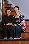 Amanda Phan and her mother Suong Nguyen at home in Plano. Nguyen, a Buddhist nun, and her children left Vietnam as refugees more than 30 years ago.  (Photo by Kevin Bartram)