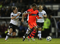 Bolton's Neil Danns breaks past Derby County's Craig Bryson - Photo mandatory by-line: Matt Bunn/JMP - Tel: Mobile: 07966 386802 16/02/2014 - SPORT - FOOTBALL - IPro Stadium - Pride Park - Derby - Derby County v Bolton - Sky Bet Championship