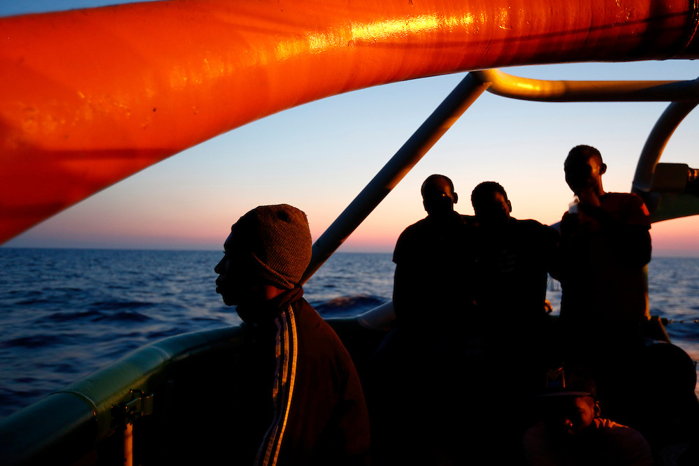 Migrants rest on the deck of the Medecins san Frontiere (MSF) ship Bourbon Argos off the coast of Libya at dusk August 7, 2015.  Some 241 mostly West African migrants on the ship are expected to arrive on the Italian island of Sicily on Sunday, according to MSF.<br /> REUTERS/Darrin Zammit Lupi <br /> MALTA OUT. NO COMMERCIAL OR EDITORIAL SALES IN MALTA