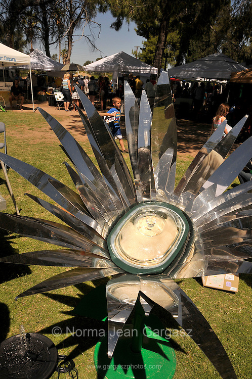 A display by Citizens for Solar features a solar oven where organic chicken cooks in a pot at the Earth Day celebration at Reid Park, Tucson, Arizona, USA.
