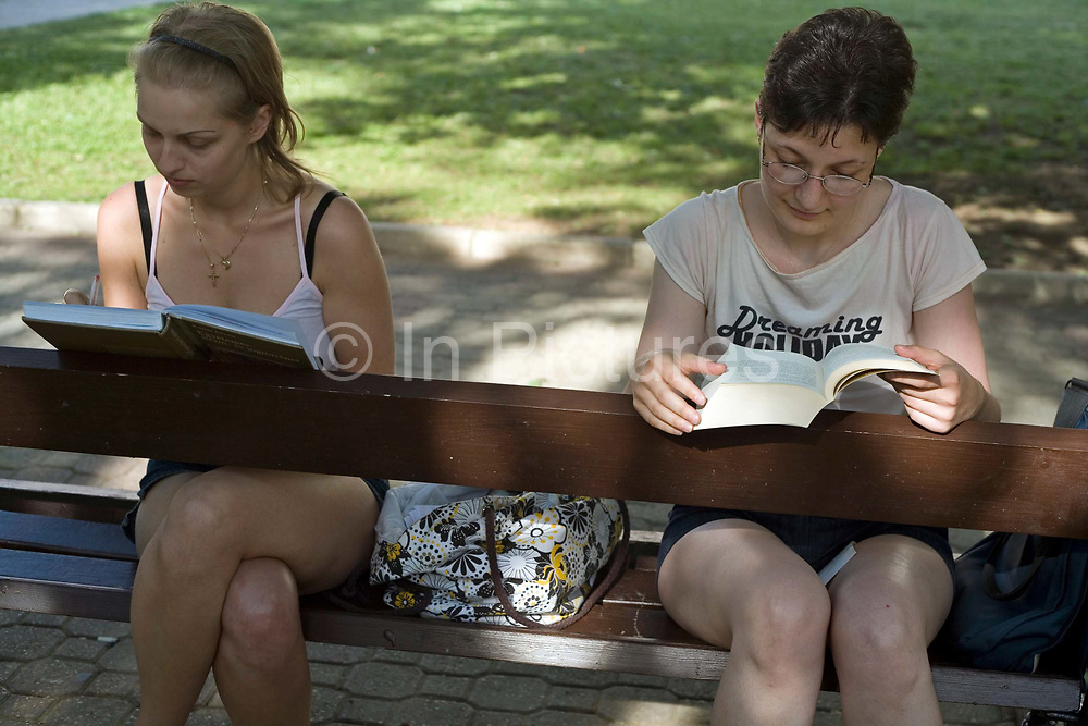 Two girls read on a park bench in Pec, Hungary.Pecs has been chosen as the 2010 European City of Culture. The city is on the southern slopes of the Mecsek Hills and has a sub-Mediterranean climate. Settled by Romans as Sopianae, it was a significant Christian settlement. Later conquered by the Ottomans, it has important Turkish architecture.