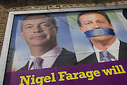 The anti-EU membership 'UK Independence Party's (UKIP) political billboard shows leader Nigel Farage and a gagged Prime Minister David Cameron - silent against a bullying European Union, seen in East Dulwich - a relatively affluent district of south London. The ad is displayed before European elections on 22nd May.