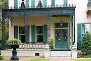 Traditional grand mansion house with wrought iron fretwork in the Garden District of New Orleans, Louisiana, USA