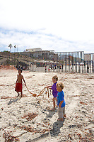 Mexican Kids Playing With Giant Kelp, Border Field State Park, California
