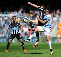 Queens Park Rangers' Joey Barton challenges for the ball with Newcastle United's Jack Colback - Photo mandatory by-line: Dougie Allward/JMP - Mobile: 07966 386802 - 16/05/2015 - SPORT - football - London - Loftus Road - QPR v Newcastle United - Barclays Premier League