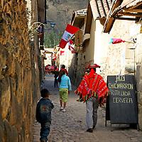 South America, Latin America, Peru, Urubamba Valley. Daily life in the quaint Incan streets of Ollanta (Olantaytambo).
