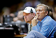 SHOT 2/14/13 9:15:20 PM - Executive vice president of football operations for the Denver Broncos John Elway watches the Colorado versus Arizona basketball game at the Coors Event Center on the Colorado campus in Boulder, Co. Colorado won the game 71-58. Elway was a legendary Broncos quarterback and local celebrity in Colorado. (Photo by Marc Piscotty / © 2013)