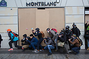 December, 8th, 2018 - Paris, Ile-de-France, France: Press photographers near Montblanc shop on Champs Elysees. The French 'Gilets Jaunes' demonstrate a fourth day. Their movement was born against French President Macron's high fuel increases. They have been joined en mass by students and trade unionists unhappy with Macron's policies. Nigel Dickinson