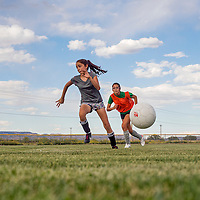 081413       Cable Hoover<br /> <br /> Sarah Espinosa, center, Amy Mascarenas and their teammates play a scrimmage game during Gallup Bengals girls soccer practice Wednesday at Gallup High School.