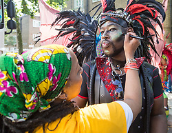 London, August 28 2017. A man's makeup is touched up on Day Two of the Notting Hill Carnival, Europe's biggest street party held over two days of the August bank holiday weekend, attracting over a million people. © Paul Davey.