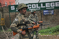 April 5, 2017 - Srinagar, Jammu and Kashmir, India - BSF troopers standing alert inside the premises of Government Higher Secondary School in Srinagar Indian Controlled Kashmir on Wednesday, April 05, 2017. The additional force companies arrived to Valley ahead of LS by-polls, slated to be held on April 09 and 12 for Srinagar and Anantnag seat respectively. (Credit Image: © Umer Asif/Pacific Press via ZUMA Wire)