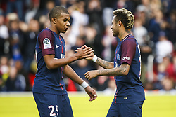 September 30, 2017 - Paris, France - Paris Saint-Germain's Brazilian forward Neymar (R) celebrates scoring the goal with Paris Saint-Germain's French forward Kylian MBappe during the French L1 football match Paris Saint-Germain (PSG) vs Bordeaux (FCGB) on September 30, 2017 at the Parc des Princes stadium in Paris. (Credit Image: © Geoffroy Van Der Hasselt/NurPhoto via ZUMA Press)