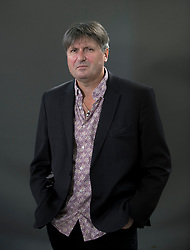 Poet Laureate Simon Armitage appears at the 2019 Edinburgh International Book Festival.<br /> <br /> The popular poetry professor and Yorkshireman has been given Britain's highest literary honour and made the UK's Poet Laureate. Today, Simon Armitage looks at the many poems he's written for standalone projects, commissions and collaborations, newly collected in Sandettie Light Vessel Automatic. Listen as the former probation officer who describes his writing as 'no-brow' explores the links between works covering everything from sculpture to travel and drama to the environment.<br /> <br /> © Dave Johnston / EEm