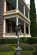 Statue of Mercury in the gardens of the Calhoun Mansion on Meeting Street in Charleston, SC. Charleston founded in 1670 is considered America's most beautifully preserved architectural and historic city.
