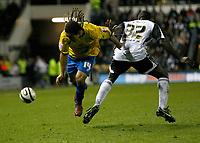 Photo: Steve Bond/Richard Lane Photography. Derby County v Crystal Palace. Coca Cola Championship. 06/12/2008. Sean Scannel (L) vaults Darren Powell (R)