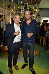 Left to right, HARRY HANDELSMAN and NOE DUCHAUFOUR-LAWRANCE at the opening of L'Eden by Perrier-Jouet held at The Unit, 147 Wardour Street, Soho, London on 15th September 2016.