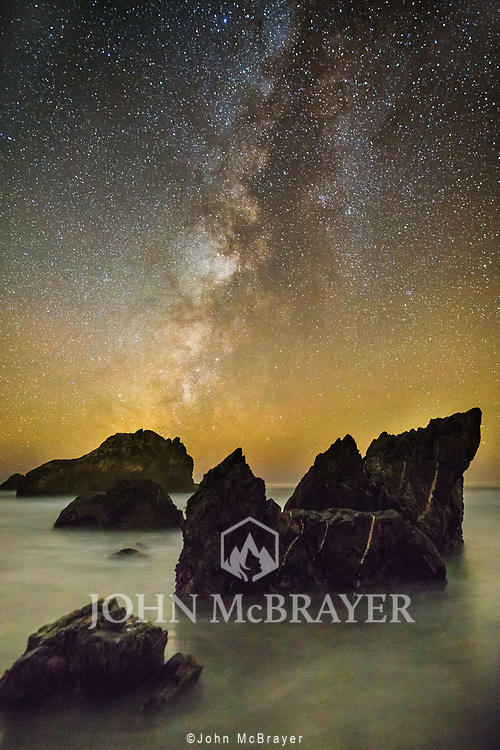 The Milky Way rises above the ocean near Big Sur. © John McBrayer