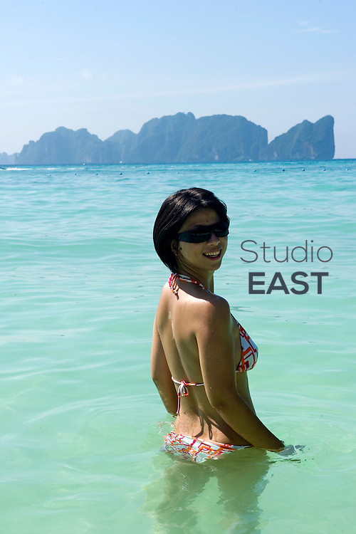KRABI PROVINCE, THAILAND - December 15: A young woman bathes from the beach of Ko Phi Phi islands on December 15, 2010 in the Adaman Sea, Krabi province, Thailand. (Photo by Lucas Schifres/Getty Images)