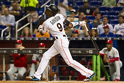 July 17, 2017 - USA - Marlins second baseman Dee Gordon hits a fly ball single as the Miami Marlins play the Philadelphia Phillies at Marlins Park on Monday, July 17, 2017 in Miami. (Credit Image: © Bryan Cereijo/TNS via ZUMA Wire)