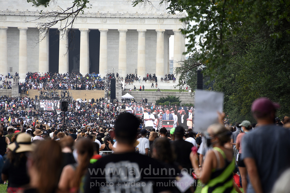 """Human rights advocate Martin Luther King III delivers a moving speech to a huge crowd at the Lincoln Memorial. On Friday, August 28th, 2020, thousands of people from all over the country attended the Commitment March in Washington, D.C.to fight for criminal justice reform in solidarity with those who have lost loved ones at the hands of the police and to push for federal legislation against misconduct. The event, organized by the Reverend Al Sharpton and the National Action Network under the rallying call 'Get Your Knee Off Our Necks,' coincides with and honors the 57thanniversary of Martin Luther King, Jr.'s March on Washington, where he delivered his historic """"I Have A Dream"""" speech in 1963. Photograph by Jay Dunn."""