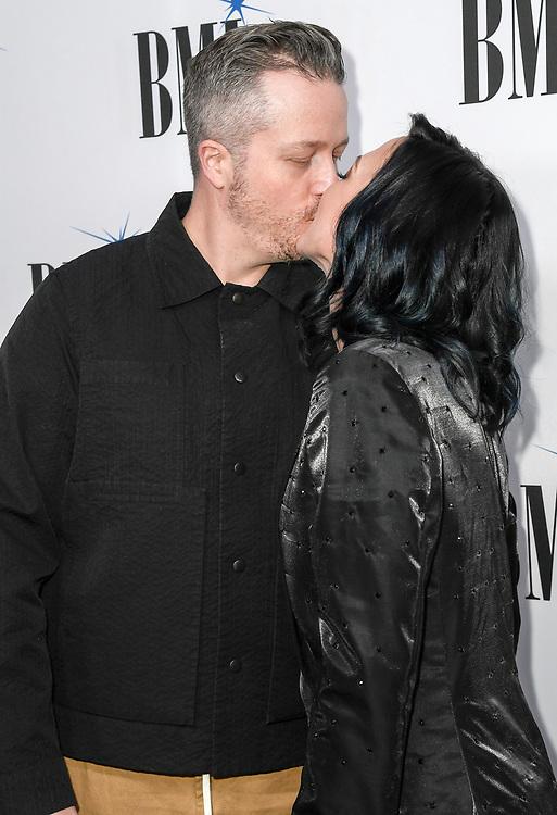 NASHVILLE, TENNESSEE - NOVEMBER 12: Jason Isbell and Amanda Shires share a kiss at the 67th Annual BMI Country Awards at BMI on November 12, 2019 in Nashville, Tennessee.