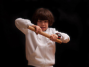 young boy attempts to fight with make believe Nunchaku sticks