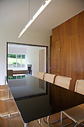 "The dining room showing the ""green table"" (referring to the reflections) looking through to the living room at Warren House, Wayne McGregor's Dartington Estate home in Devon<br /> Vanessa Berberian for The Wall Street Journal"