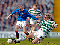 Photo. Jed Wee.Digitalsport<br /> Glasgow Celtic v Glasgow Rangers, Scottish FA Cup, Celtic Park, Glasgow. 07/03/2004.<br /> Rangers' Stephen Hughes (L) is tackled by Celtic's Stanislav Varga.