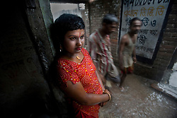 Sex worker Shuri, 15, waits for a customer at brothel, June 7, 2007 in Tangail, Bangladesh. Shuri was born into brothel and adopted by another sex worker. <br /> The majority of the 20,000 to 30,000 female sex workers in Bangladesh are victims of trafficking. <br /> Once they enter the brothel, usually before the age of 12, they are generally in for life because of social stigma and poverty.
