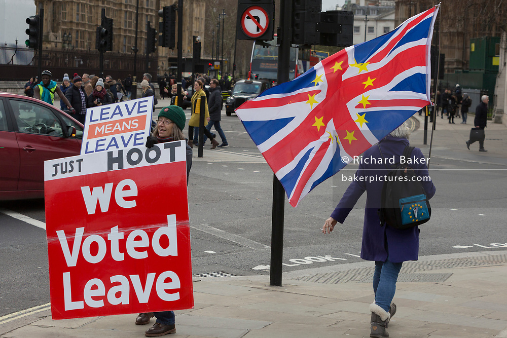 A pro-Brexiter protestor and a Pro-EU Remainer at the junction of Parliament Square in a week that Prime Minister Theresa May asks for MPs to back her Brexit deal, on 14th January 2019, in Westminster, London, England.