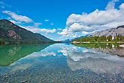 Coulds refflected in Muncho Lake. Northern Rocky Mountains<br />