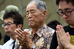 August 9, 2017 - Nagasaki, Nagasaki Prefecture, Japan - Visitors lays flowers and pray for the atomic bomb victims in front of the Nagasaki Peace Park in Nagasaki, southern Japan on Wednesday. Japan marked the 72nd anniversary of the atomic bombing on Nagasaki.  (Credit Image: © Richard Atrero De Guzman/NurPhoto via ZUMA Press)