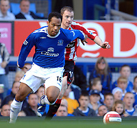 Photo: Paul Greenwood.<br />Everton v Sheffield United. The Barclays Premiership. 21/10/2006. Evertons Joleon Lescott, left holds off the challenge of Alan Quinn
