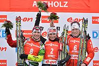 Skiskyting<br /> Anterselva Italia<br /> IBU World Cup<br /> 18.01.2014<br /> Foto: Gepa/Digitalsport<br /> NORWAY ONLY<br /> <br /> IBU Weltcup, 10km Verfolgung der Damen, Siegerehrung. Bild zeigt den Jubel von Nadezhda Skardino (BLR), Andrea Henkel (GER) und Tora Berger (NOR).