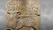 Hittite relief sculpted orthostat stone panel of Long Wall Limestone, Karkamıs, (Kargamıs), Carchemish (Karkemish), 900 - 700 B.C. Anatolian Civilisations Museum, Ankara, Turkey<br /> <br /> Chariot. One of the two figures in the chariot holds the horse's headstall while the other throws arrows. There is a naked enemy with an arrow in his hip lying face down under the horse's feet It is thought that this figure is depicted smaller than the other figures since it is an enemy soldier. The lower part of the orthostat is decorated with braiding motifs. <br /> <br /> On a grey art background. .<br />  <br /> IIf you prefer to buy from our ALAMY STOCK LIBRARY page at https://www.alamy.com/portfolio/paul-williams-funkystock/hittite-art-antiquities.html  - Type  Karkamıs in LOWER SEARCH WITHIN GALLERY box. Refine search by adding background colour, place, museum etc.<br /> <br /> Visit our HITTITE PHOTO COLLECTIONS for more photos to download or buy as wall art prints https://funkystock.photoshelter.com/gallery-collection/The-Hittites-Art-Artefacts-Antiquities-Historic-Sites-Pictures-Images-of/C0000NUBSMhSc3Oo