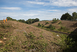 HS2 workers survey ground clearance work for the HS2 high-speed rail link on 13th July 2020 in Harefield, United Kingdom. Thousands of trees have been felled in the Colne Valley for the £106bn project which will remain a net contributor to CO2 emissions during its projected 120-year lifetime.