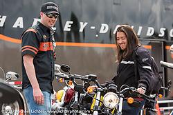 Harley-Davidson's Nate Engbos talks with Johnathon Valderrama of Orlando, FL before Jonathan's test ride of a new 2017 Harley-Davidson at the HD Speedway display during Daytona Beach Bike Week. FL. USA. Sunday March 12, 2017. Photography ©2017 Michael Lichter.