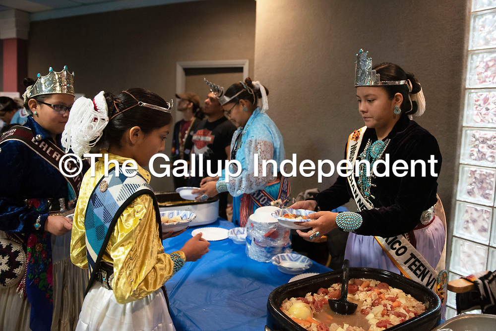 Miss Eastern Navajo 'At'ééd Yázhí, Shundiin Antonio, left, and Tehya Barber, Miss Indian New Mexico teen serve stew to attendees at the New Mexico Indigenous Women's Resource Council launch celebration at Rio West Mall in Gallup Saturday.