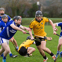 Clonlara's Ian Galvin get's away with the slíotar while surrounded by Cratloe players