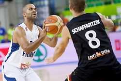 04.09.2013, Hala Tivoli, Ljublijana, SLO, Eurobasket EM 2013, Frankreich vs Deutschland, im Bild Tony Parker #9 of France and Heiko Schaffartzik #8 of Germany // during the Eurobasket EM 2013 match between France and Germany at Hala Tivoli in Ljubljana, Slowenia on 2013/09/04. EXPA Pictures © 2013, PhotoCredit: EXPA/ Sportida/ Urban Urbanc<br /> <br /> ***** ATTENTION - OUT OF SLO *****
