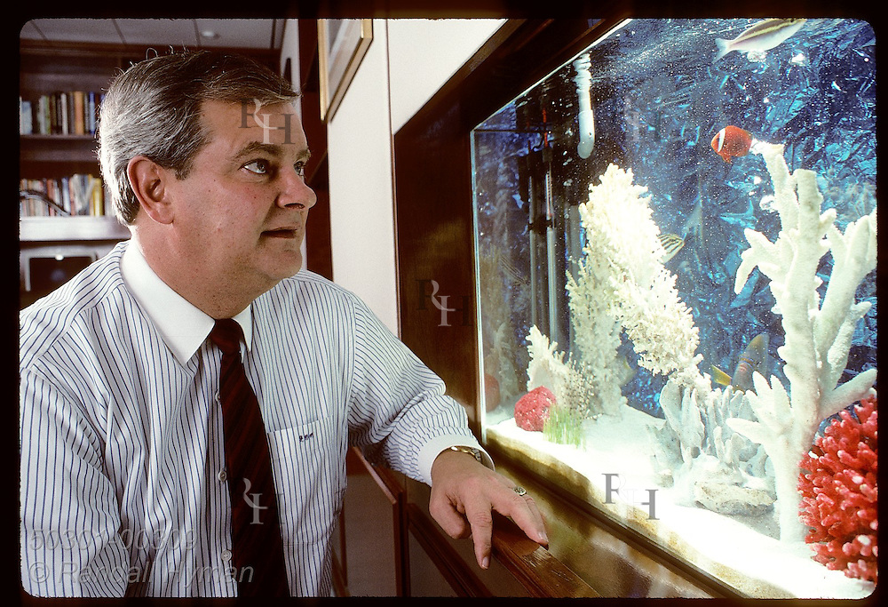 Monsanto Far East Limted's Bob Fissmer admires fish tank put in office to promote good Feng Shui Hong Kong