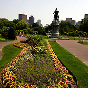 BOSTON, MASS- July 13, 2005:  Visitors to Boston Common are treated to a statue of George Washington amid the manicured grass and flower beds in Boston, Massachusetts on July 13, 2005. (Photo by Todd Bigelow/Aurora)