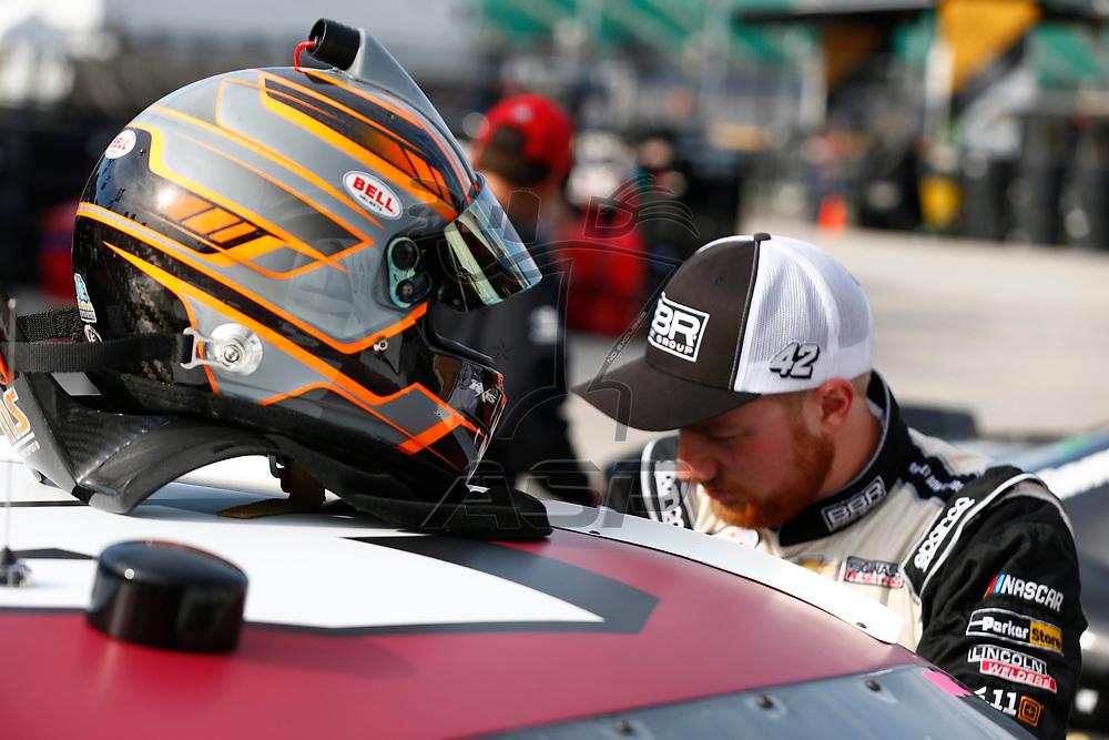 October 20, 2017 - Kansas City, Kansas, USA: Tyler Reddick (42) hangs out in the garage during practice for the Kansas Lottery 300 at Kansas Speedway in Kansas City, Kansas.