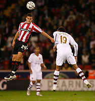 Photo: Steve Bond.<br /> Sheffield United v Arsenal. Carling Cup. 31/10/2007. Billy Sharp (L) wins a header against Gilberto (R)